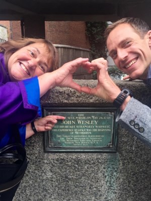 Photo of Bishop Karen Oliveto at the site where John Wesley's heart was strangely warmed.