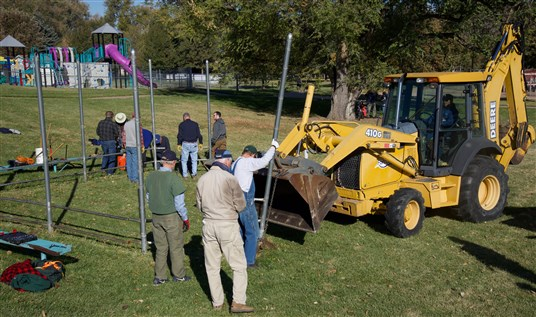 Bulldozer works in Eastside Park with members of Fort Collins UMC.